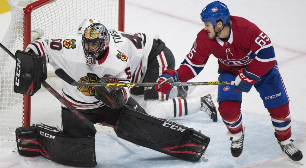 Chicago-Blackhawks-goalie-Corey-Crawford-(50)-makes-a-save-as-Montreal-Canadiens'-Andrew-Shaw-(65)-looks-for-the-rebound-during-first-period-NHL-hockey-action-in-Montreal,-Tuesday,-October-10,-2017.-(Graham-Hughes/CP)