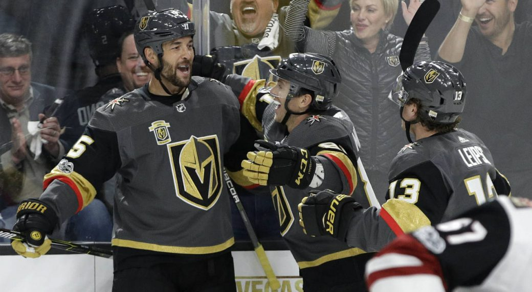 Vegas-Golden-Knights-defenceman-Deryk-Engelland,-left,-celebrates-after-scoring-against-the-Arizona-Coyotes-during-the-first-period-of-an-NHL-hockey-game-Tuesday,-Oct.-10,-2017,-in-Las-Vegas.-(John-Locher/AP)