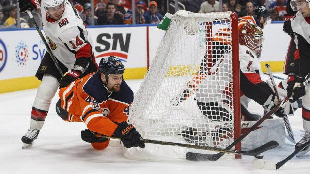 Ottawa-Senators'-Alex-Burrows-(14)-hooks-Edmonton-Oilers'-Zack-Kassian-(44)-as-he-tries-to-put-the-puck-past-goalie-Mike-Condon-(1)-during-second-period-NHL-action-in-Edmonton-on-Saturday,-October-14,-2017.-(Jason-Franson/CP)