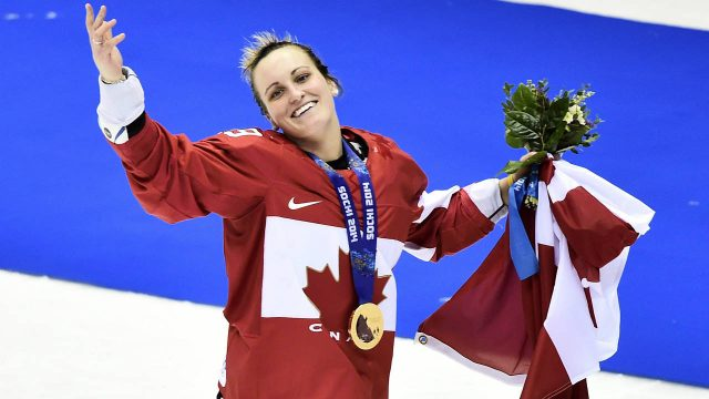 Canada's-Marie-Philip-Poulin-waves-the-crowd-after-scoring-the-game-winning-goal-to-defeat-the-United-States-in-overtime-in-gold-medal-women's-hockey-final-at-the-2014-Sochi-Winter-Olympics.-(Nathan-Denette/CP)