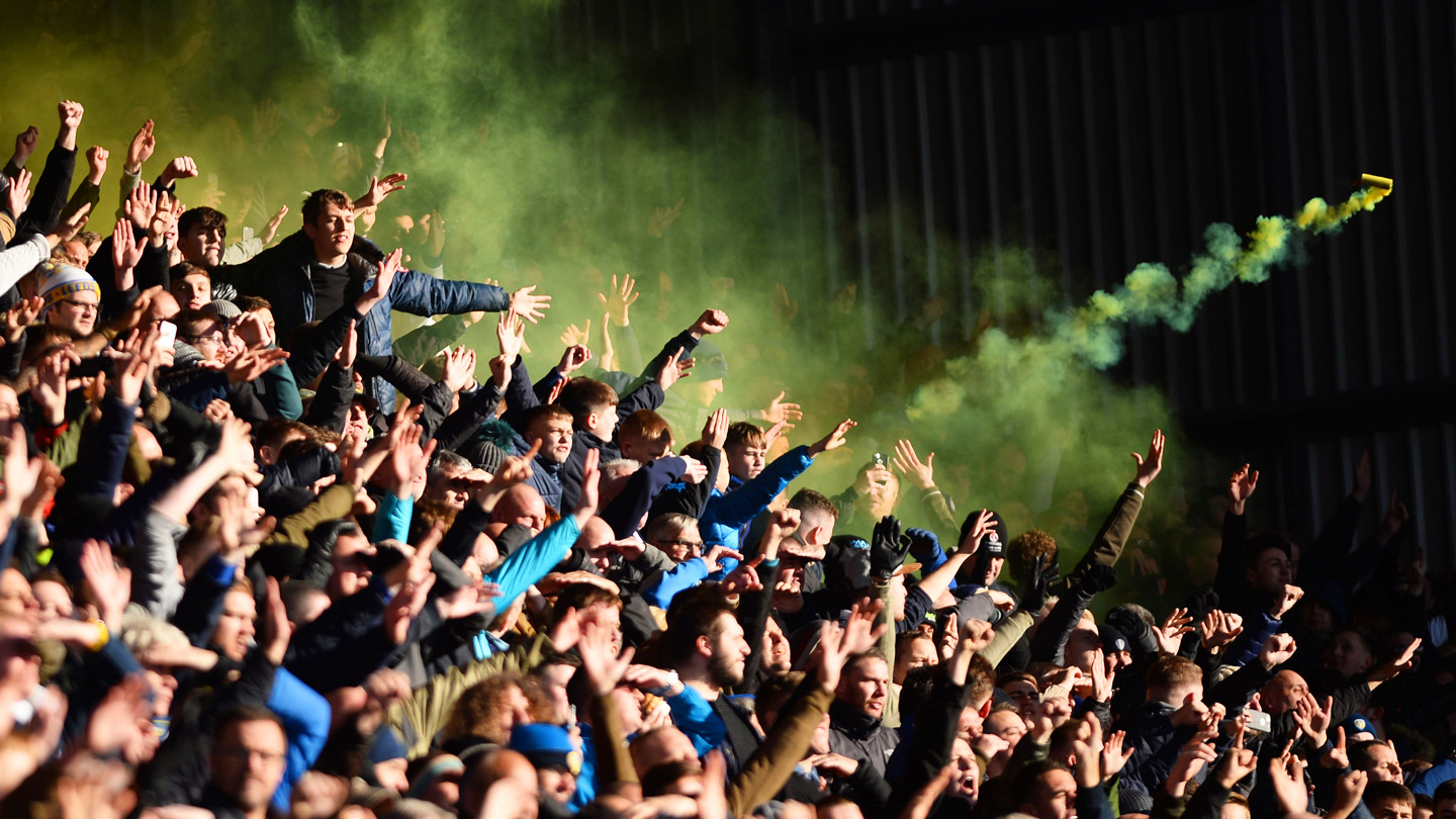 A-smoke-canister-is-thrown-from-the-Leeds-United-fan-section-during-a-Sky-Bet-Championship-game-against-Barnsley-FC.