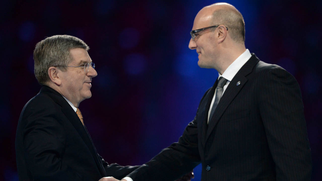 International-Olympic-Committee-President-Thomas-Bach,-left,-shakes-hands-with-KHL-president-Dmitry-Chernyshenko.-(Jung-Yeon-je,-Pool/AP)