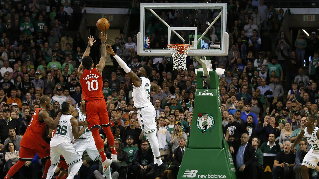 Toronto-Raptors'-DeMar-DeRozan-(10)-can't-make-a-shot-over-Boston-Celtics'-Jaylen-Brown-with-3.5-seconds-left-in-the-fourth-quarter-of-Boston's-95-94-win-over-the-Toronto-Raptors-in-an-NBA-basketball-game-in-Boston-Sunday,-Nov.-12,-2017.-(Winslow-Townson/AP)