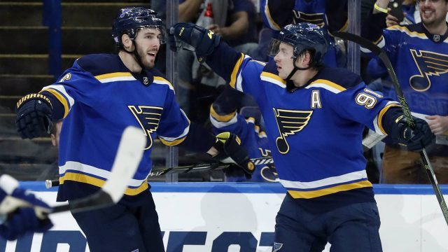 St.-Louis-Blues'-Joel-Edmundson,-left,-is-congratulated-by-St.-Louis-Blues'-Vladimir-Tarasenko,-of-Russia,-after-scoring-during-the-second-period-of-an-NHL-hockey-game-against-the-Toronto-Maple-Leafs-Saturday,-Nov.-4,-2017,-in-St.-Louis.-(Jeff-Roberson/AP)