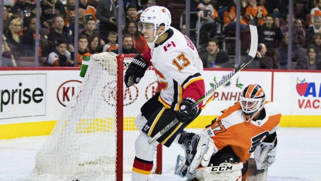 Calgary-Flames'-Johnny-Gaudreau,-left,-scores-a-goal-on-Philadelphia-Flyers'-Brian-Elliott,-right,-during-the-first-period-of-an-NHL-hockey-game,-Saturday,-Nov.-18,-2017,-in-Philadelphia.-(Chris-Szagola/AP)