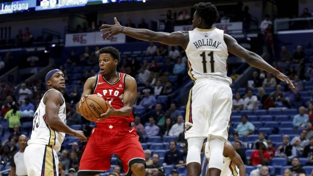 Toronto-Raptors-guard-Kyle-Lowry-(7)-looks-to-pass-against-New-Orleans-Pelicans-forward-Dante-Cunningham-(33)-and-guard-Jrue-Holiday-(11)-in-the-first-half-of-an-NBA-basketball-game-in-New-Orleans,-Wednesday,-Nov.-15,-2017.-(Scott-Threlkeld/AP)