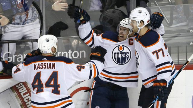 Edmonton-Oilers-right-wing-Zack-Kassian-(44)-and-Oilers-defenceman-Oscar-Klefbom-(77)-of-Sweden-celebrate-with-Oilers-center-Connor-McDavid-(97)-after-McDavid-scored-the-game-winning-goal-in-overtime-of-an-NHL-hockey-game-against-the-New-York-Islanders-in-New-York,-Tuesday,-Nov.-7,-2017.-The-final-score-was-2-1.-(Kathy-Willens/AP)
