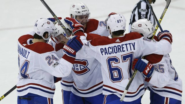 Montreal-Canadiens'-Phillip-Danault-(24),-Jeff-Petry-(26),-Karl-Alzner-(22),-Max-Pacioretty-(67)-and-Andrew-Shaw-(65)-celebrate-Petry's-tying-goal-against-the-Winnipeg-Jets-during-the-third-period-of-NHL-action-in-Winnipeg-on-Saturday,-November-4,-2017.-(John-Woods/CP)