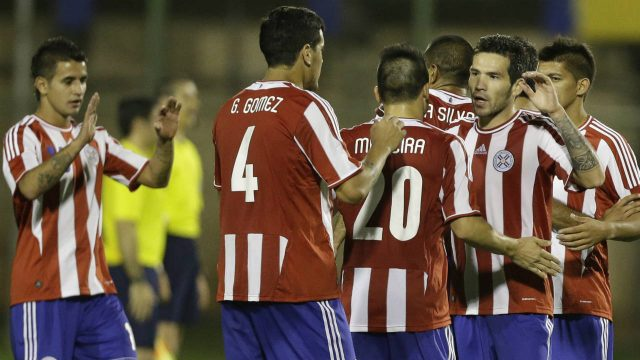 Peru's-Jose-Guerrero,-left,-fights-for-the-ball-with-Paraguay's-Victor-Caceres-during-a-FIFA-friendly-soccer-match-in-Luque,-Paraguay,-Friday,-Nov.-14,-2014.-(Jorge-Saenz/AP)