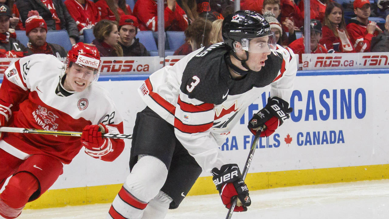Canada's-Conor-Timmins-(3)-carries-the-puck-past-Denmark's-Andreas-Grundtvig-during-second-period-IIHF-World-Junior-Championship-preliminary-action-in-Buffalo,-N.Y.,-Saturday,-December-30,-2017.-(Mark-Blinch/CP)