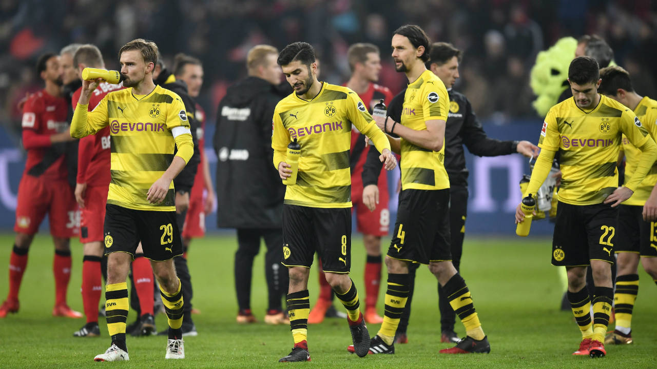 Dortmund's-players-leave-the-pitch-disappointed-after-the-German-Bundesliga-soccer-match-between-Bayer-Leverkusen-and-Borussia-Dortmund-in-Leverkusen,-Germany,-Saturday,-Dec.-2,-2017.-The-match-ended-1-1.-(Martin-Meissner/AP)