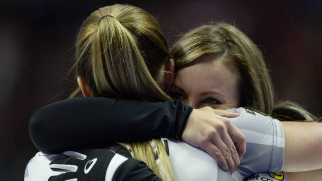 Rachel-Homan,-right,-and-Lisa-Weagle-hug-each-other-after-winning-the-2017-Roar-of-the-Rings-Canadian-Olympic-Trials-in-Ottawa-on-Sunday,-Dec.-10,-2017.-Homan-and-her-Ottawa-based-curling-team-will-represent-Canada-at-the-Winter-Olympics.-(Adrian-Wyld/CP)