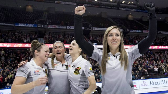 Skip-Rachel-Homan-of-Ottawa,-Ont.-pumps-her-fists-as-second-Joanne-Courtney,-third-Emma-Miskew-and-lead-Lisa-Weagle-celebrate-defeating-Team-Carey-in-the-women's-final-at-the-2017-Roar-of-the-Rings-Canadian-Olympic-Trials-in-Ottawa-on-Sunday,-Dec.-10,-2017.-(Justin-Tang/CP)