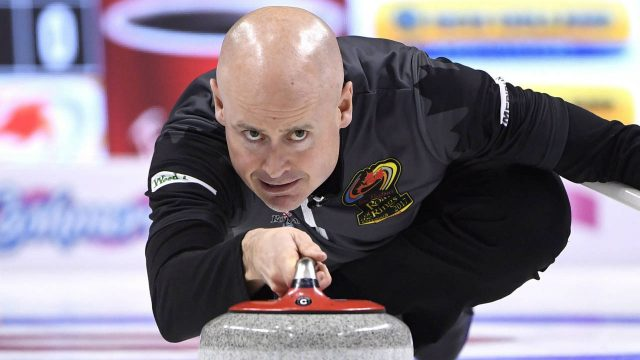 Team-Koe-skip-Kevin-Koe-throws-a-rock-during-a-draw-against-Team-Laycock-at-the-2017-Roar-of-the-Rings-Canadian-Olympic-Curling-Trials-in-Ottawa-on-Saturday,-Dec.-2,-2017.-(Justin-Tang/CP)