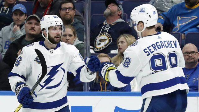 Tampa-Bay-Lightning's-Nikita-Kucherov,-of-Russia,-is-congratulated-by-Mikhail-Sergachev,-right,-of-Russia,-after-scoring-during-the-third-period-of-an-NHL-hockey-game-against-the-St.-Louis-Blues-Tuesday,-Dec.-12,-2017,-in-St.-Louis.-The-Lightning-won-3-0.-(Jeff-Roberson/AP)