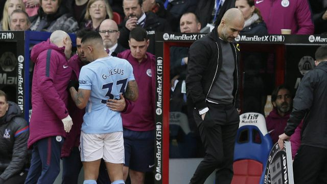 Manchester-City-manager-Pep-Guardiola,-right,-looks-dejected-as-Manchester-City's-Gabriel-Jesus-is-taken-off-the-pitch-injured-during-the-English-Premier-League-soccer-match-between-Crystal-Palace-and-Manchester-City-at-Selhurst-Park-in-London,-Sunday-Dec.-31,-2017.-(Tim-Ireland/AP)
