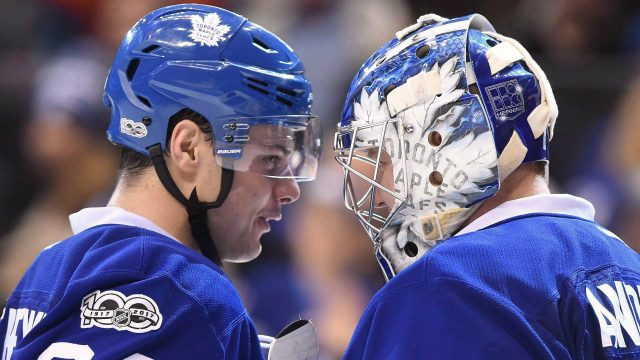 Toronto-Maple-Leafs-centre-Auston-Matthews-(34)-and-goalie-Frederik-Andersen-(31)-congratulate-each-other-after-their-win-over-the-New-York-Islanders-following-NHL-hockey-action-in-Toronto-on-Feb.14,-2017.-NHL-rookie-classes-like-this-one-don't-come-around-very-often.-It's-been-almost-25-years-since-we-last-saw-three-rookies-hit-both-the-20-goal-and-70-point-plateaus-in-the-same-season-(1992-93).-Auston-Matthews,-Patrik-Laine-and-Mitch-Marner-are-all-on-pace-to-do-it-this-year.-(Frank-Gunn/CP)