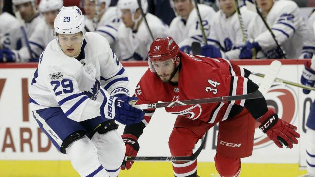 Toronto-Maple-Leafs'-William-Nylander-(29)-and-Carolina-Hurricanes'-Phillip-Di-Giuseppe-(34)-chase-the-puck-during-the-second-period-of-an-NHL-hockey-game-in-Raleigh,-N.C.,-Friday,-Nov.-24,-2017.-(Gerry-Broome/AP)