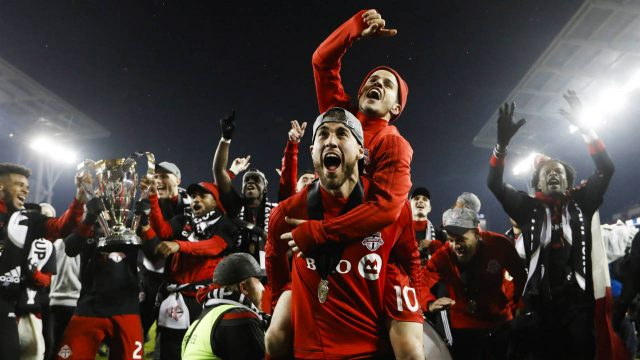 Toronto-FC-Sebastian-Giovinco-jumps-on-Jonathan-Osorio-after-defeating-the-Seattle-Sounders-to-win-the-MLS-Cup-in-Toronto-on-Saturday,-December-9,-2017.-(Mark-Blinch/CP)