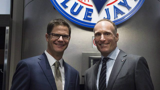 Toronto-Blue-Jays-new-general-manager-Ross-Atkins,-left,-and-Blue-Jays-president-and-CEO-Mark-Shapiro-pose-for-a-photograph-before-a-press-conference-in-Toronto-on-Friday,-December-4,-2015.-(Nathan-Denette/CP)