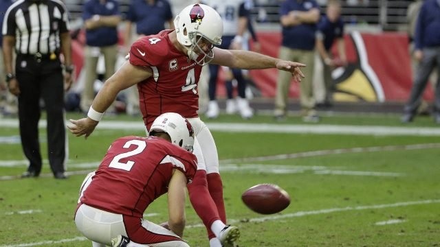 Arizona-Cardinals-kicker-Phil-Dawson-(4)-connects-for-a-field-goal-against-the-Tennessee-Titans-as-he-is-joined-by-holder-Arizona-Cardinals-punter-Andy-Lee-(2)-during-the-second-half-of-an-NFL-football-game,-Sunday,-Dec.10,-2017,-in-Glendale,-Ariz.-(Rick-Scuteri/AP)
