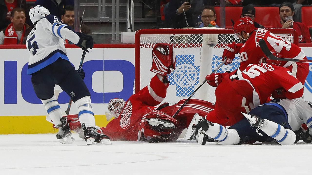 Detroit-Red-Wings-goalie-Jimmy-Howard-(35)-stops-a-Winnipeg-Jets-defenseman-Dmitry-Kulikov-(5)-shot-in-the-second-period-of-an-NHL-hockey-game-Tuesday,-Dec.-5,-2017,-in-Detroit.-(Paul-Sancya/AP)