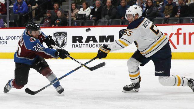 Colorado-Avalanche-centre-Rocco-Grimaldi,-left,-has-his-shot-deflected-by-Buffalo-Sabres-defenceman-Rasmus-Ristolainen-during-the-third-period-of-an-NHL-hockey-game-Tuesday,-Dec.-5,-2017,-in-Denver.-Buffalo-won-4-2.-(David-Zalubowski/AP)