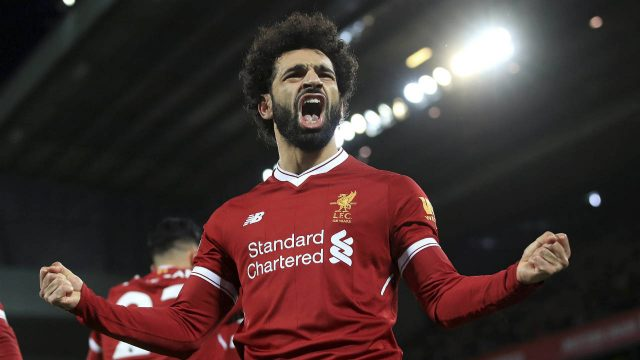 Liverpool's-Mohamed-Salah-celebrates-scoring-his-side's-second-goal-against-Leicester-City-during-the-English-Premier-League-soccer-match-at-Anfield,-Liverpool,-England,-Saturday-Dec.-30,-2017.-(Peter-Byrne/PA-via-AP)