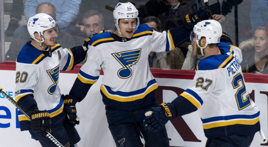 St.-Louis-Blues'-Brayden-Schenn,-centre,-celebrates-his-second-goal-with-teammates-Alexander-Steen,-left,-and-Alex-Pietrangelo-during-second-period-NHL-hockey-action-against-the-Montreal-Canadiens,-in-Montreal-on-Tuesday,-December-5,-2017.-(Paul-Chiasson/CP)
