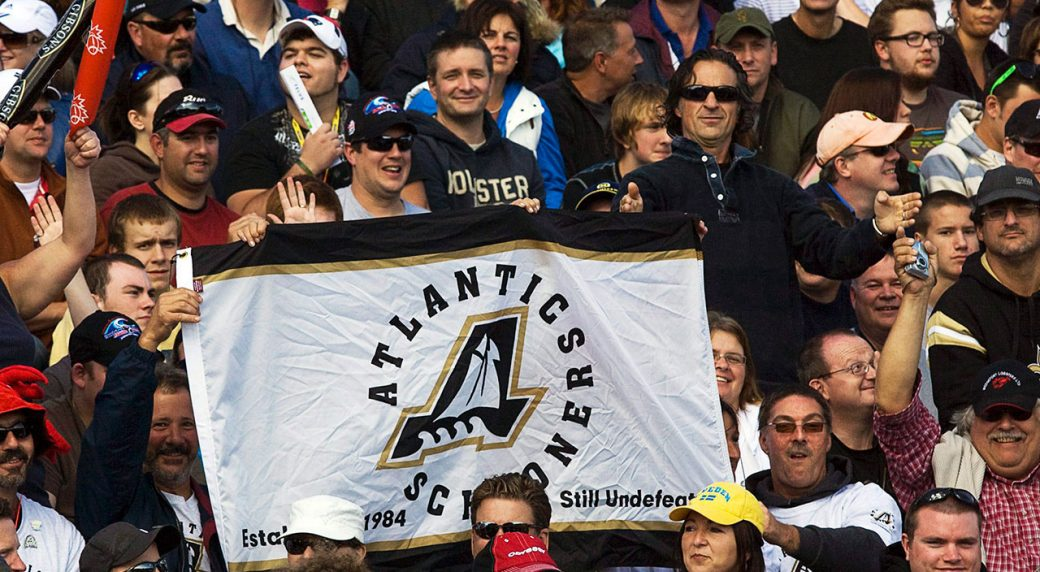 Fans-display-an-Atlantic-Schooners-banner-at-the-Toronto-Edmonton-CFL-game-at-Moncton-Stadium-in-Moncton,-N.B.-on-Sunday,-Sept.-26,-2010.-The-team-was-to-join-the-CFL-in-the-1980s-but-never-played-a-game-because-funding-could-not-be-secured-for-a-stadium.-(Andrew-Vaughan/CP)