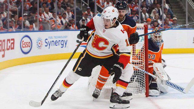 Calgary-Flames'-Matthew-Tkachuk-and-Edmonton-Oilers'-Kris-Russell