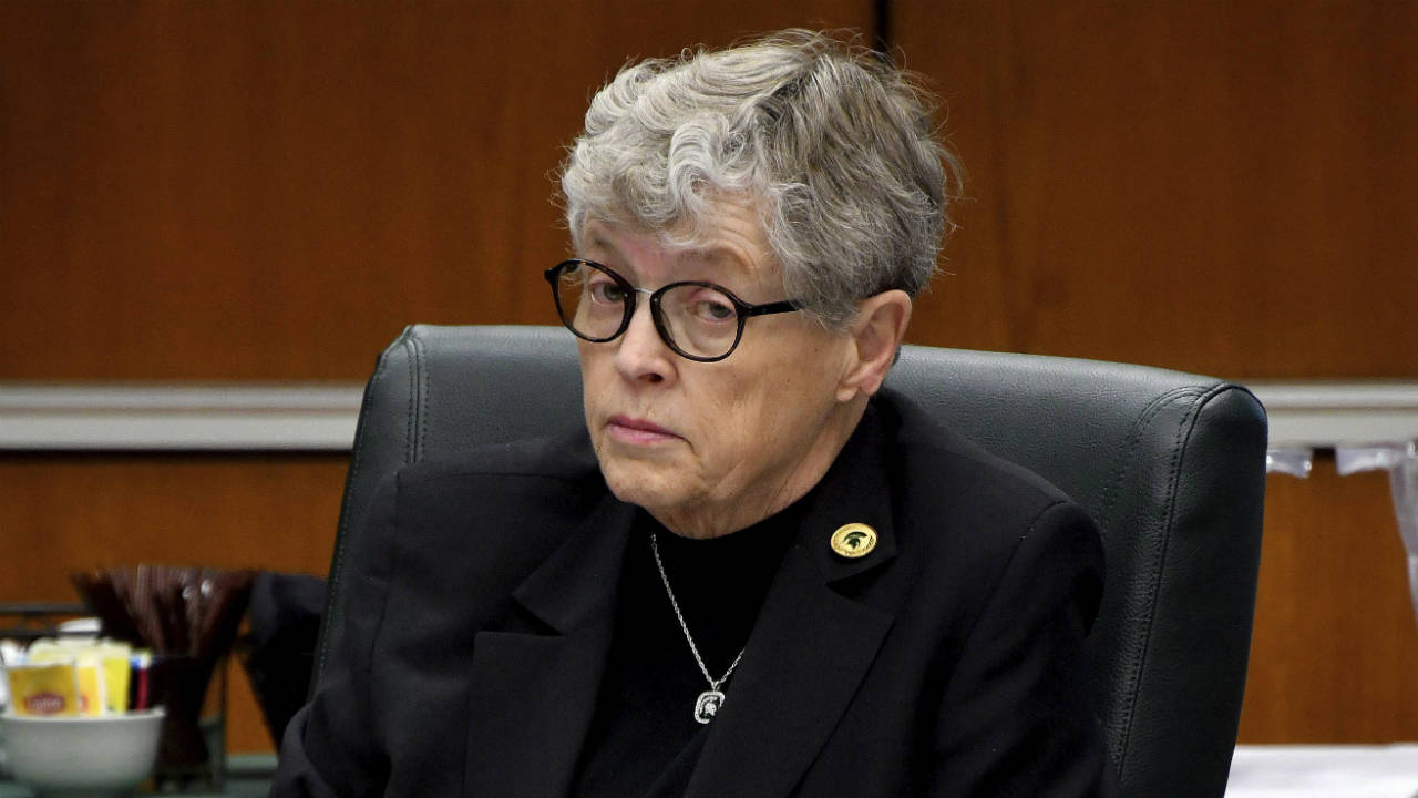 Michigan-State-president-Lou-Anna-K.-Simon-listens-during-a-MSU-Board-of-Trustees-meeting-Friday-morning,-Dec-15,-2017,-in-East-Lansing,-Mich.-(Dale-G-Young/Detroit-News-via-AP)