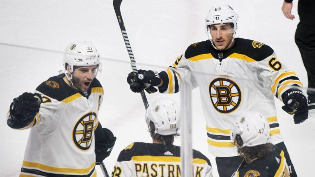 Boston-Bruins'-David-Pastrnak-(88)-celebrates-with-teammates-Patrice-Bergeron-(37),-Brad-Marchand-(63)-and-Torey-Krug-after-scoring-against-the-Montreal-Canadiens-during-second-period-NHL-hockey-action-in-Montreal,-Saturday,-January-20,-2018.-(Graham-Hughes/CP)