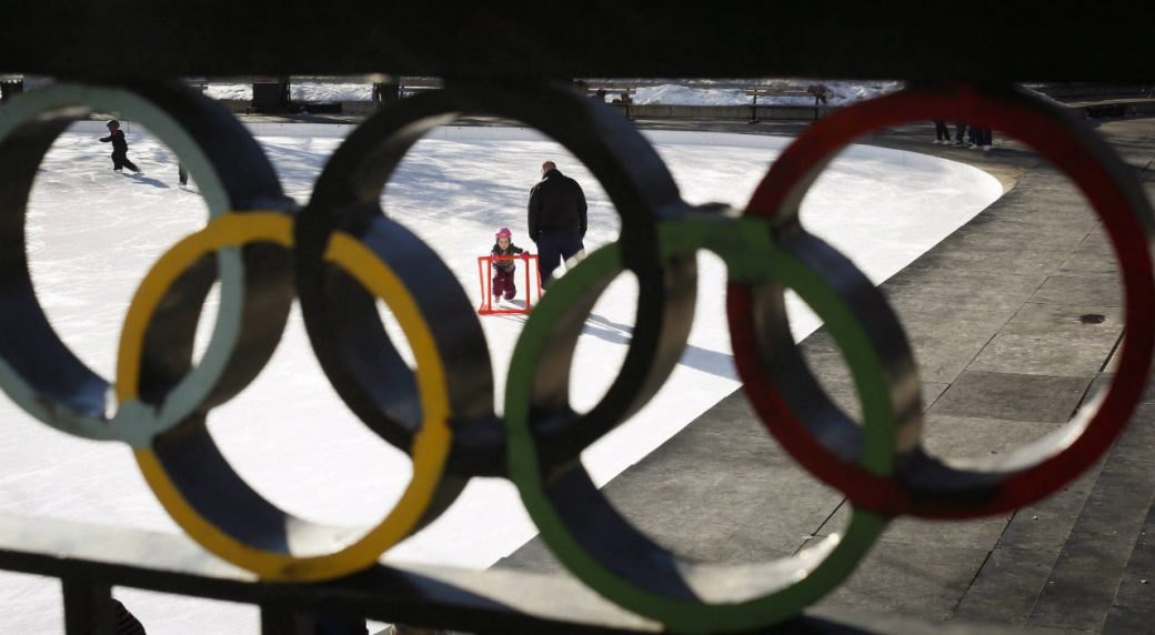A-young-girl-learns-to-skate-on-the-ice-at-the-1988-Calgary-Olympic-Plaza-on-a-warm-day-in-Calgary,-Alta.,-Sunday,-Jan.-19,-2014.-The-City-of-Calgary-is-being-urged-to-wait-for-more-details-from-the-International-Olympic-Committee-before-deciding-whether-to-bid-for-the-2026-Games.The-17-member-Calgary-Bid-Exploration-Committee-has-concluded-that-it's-feasible-for-the-host-of-the-1988-Winter-Games-to-have-another-turn,-but-recommends-Calgary-take-more-time-to-determine-whether-it's-a-good-idea.-(Jeff-McIntosh/CP)