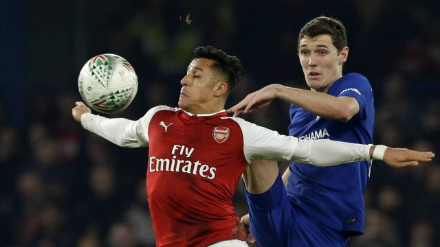 Arsenal's-Alexis-Sanchez,-left,-challenges-for-the-ball-with-Chelsea's-Andreas-Christensen-during-the-English-League-Cup-semifinal,-first-leg,-soccer-match-between-Chelsea-and-Arsenal-at-Stamford-Bridge-stadium-in-London,-Wednesday,-Jan.-10,-2018.-(Alastair-Grant/AP)