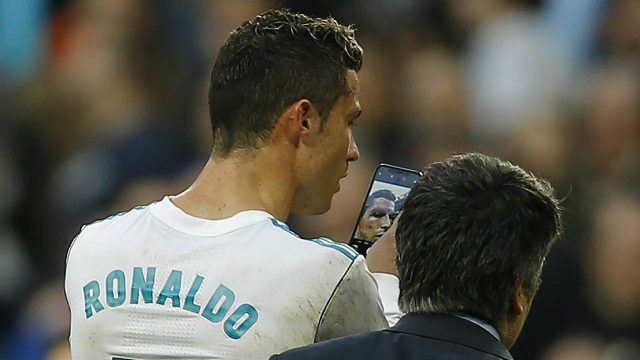 Real-Madrid's-Cristiano-Ronaldo-leaves-the-pitch-as-he-uses-a-phone-to-look-at-himself-while-bleeding-from-his-forehead-during-a-Spanish-La-Liga-soccer-match-between-Real-Madrid-and-Deportivo-Coruna-at-the-Santiago-Bernabeu-stadium-in-Madrid,-Sunday,-Jan.-21,-2018.-Ronaldo-scored-twice-in-Real-Madrid's-7-1-victory.-(Francisco-Seco/AP)