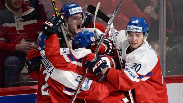 Czech-Republic-forward-Tomas-Soustal-(15),-top,-celebrates-his-goal-against-Canada-with-teammates-defenceman-Frantisek-Hrdinka-(12)-forward-Kristian-Reichel-(25)-and-defenceman-Jakub-Zboril-(20).-(Paul-Chiasson/AP)