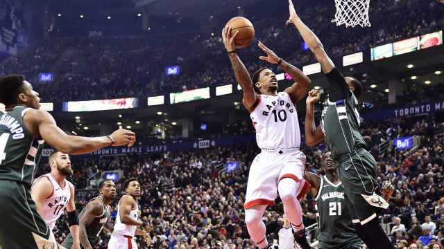 Toronto-Raptors-guard-DeMar-DeRozan-(10)-shoots-over-Milwaukee-Bucks-forward-John-Henson-(31)-during-first-half-NBA-basketball-action-in-Toronto-on-Monday,-January-1,-2018.-(Frank-Gunn/CP)
