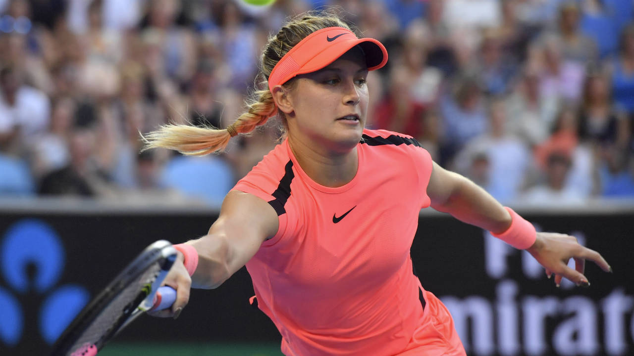 Canada's-Eugenie-Bouchard-reaches-for-a-return-to-Romania's-Simona-Halep-during-their-second-round-match-at-the-Australian-Open-tennis-championships-in-Melbourne,-Australia,-Thursday,-Jan.-18,-2018.-(Andy-Brownbill/AP)