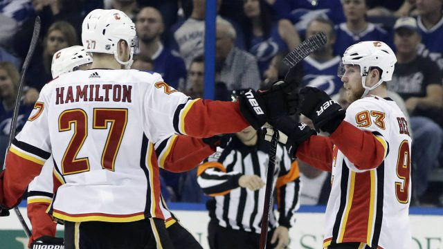 Calgary-Flames-centre-Sam-Bennett-(93)-celebrates-his-goal-against-the-Tampa-Bay-Lightning-with-defenceman-Dougie-Hamilton-(27)-during-the-second-period-of-an-NHL-hockey-game-Thursday,-Jan.-11,-2018,-in-Tampa,-Fla.-(Chris-O'Meara/AP)