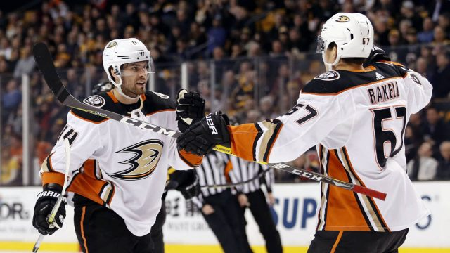 Anaheim-Ducks'-Adam-Henrique-(14)-celebrates-his-goal-against-the-Boston-Bruins-with-teammate-Rickard-Rakell-during-the-first-period-of-an-NHL-hockey-game-Tuesday,-Jan.-30,-2018,-in-Boston.-(Winslow-Townson/AP)