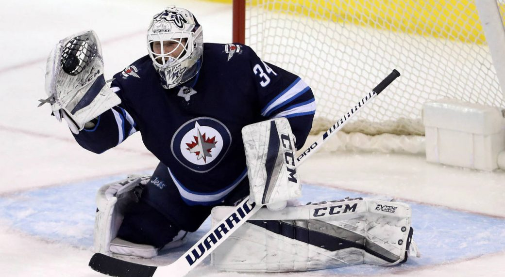 Winnipeg-Jets'-goaltender-Michael-Hutchinson-(34)-makes-a-glove-save-against-the-Tampa-Bay-Lightning-during-third-period-NHL-hockey-action-in-Winnipeg,-Tuesday,-January-30,-2018.-(Trevor-Hagan/CP)