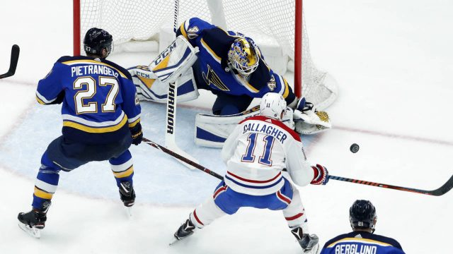 Montreal-Canadiens'-Brendan-Gallagher-(11)-is-unable-to-get-off-a-shot-as-St.-Louis-Blues-goaltender-Carter-Hutton-and-Alex-Pietrangelo-(27)-defend-during-the-second-period-of-an-NHL-hockey-game-Tuesday,-Jan.-30,-2018,-in-St.-Louis.-(Jeff-Roberson/AP)