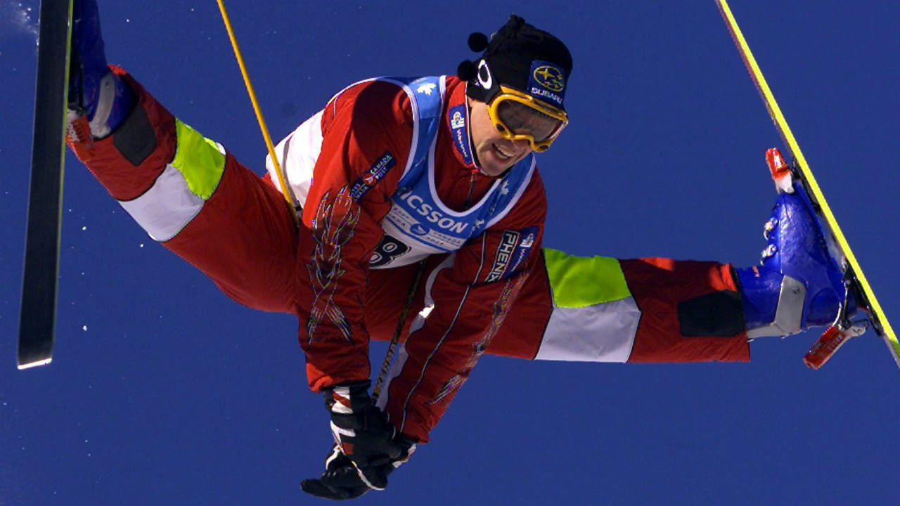 Jean-Luc-Brassard-of-Grande-Ile,-Que.-does-his-famous-Cossack-jump-in-the-men's-moguls-event-at-the-World-Cup-Freestyle-competition-Saturday,-Jan.-15,-2000-in-Mont-Tremblant,-Que.-Even-the-former-king-of-the-moguls-Jean-Luc-Brassard-can't-believe-what-Mikael-Kingsbury-has-accomplished-in-the-past-year.-(Paul-Chiasson/CP)