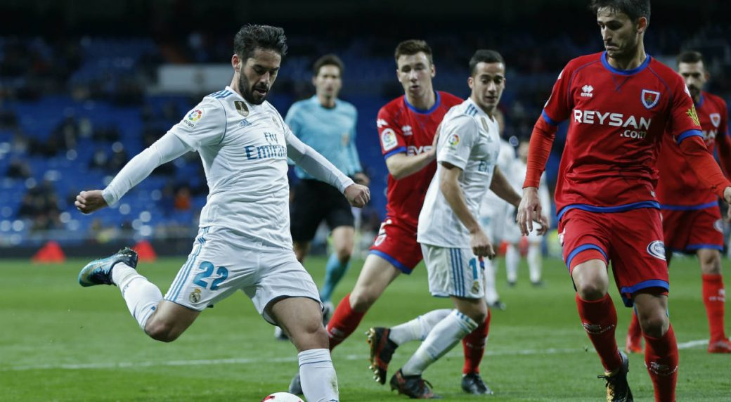 "Real-Madrid's-Francisco-Roman-""Isco"",-left,-shoots-the-ball-next-to-Numancia's-Unai-Elgezabal-during-the-Spanish-Copa-del-Rey-round-of-16-second-leg-soccer-match-between-Real-Madrid-and-Numancia-at-the-Santiago-Bernabeu-stadium-in-Madrid,-Wednesday,-Jan.-10,-2018.-Real-Madrid-won-5-2-on-aggregate.-(Francisco-Seco/AP)"