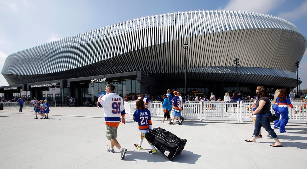 Hockey-fans-make-their-way-toward-the-entrances-of-the-renovated-Nassau-Veterans-Memorial-Coliseum-before-a-preseason-NHL-hockey-game-between-the-New-York-Islanders-and-the-Philadelphia-Flyers-in-Uniondale,-N.Y.,-Sunday,-Sept.-17,-2017.-(Kathy-Willens/AP)