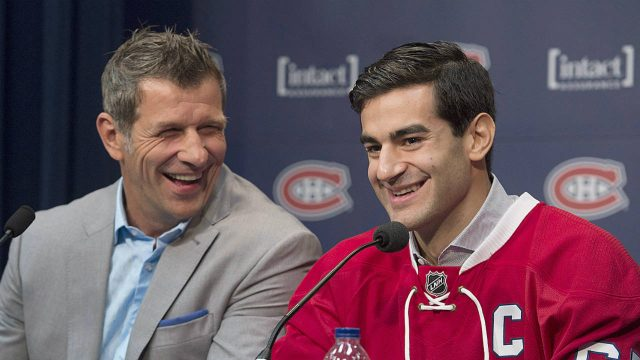 Montreal-Canadiens'-Max-Pacioretty,-right,-and-Canadiens-General-Manager-Marc-Bergevin-laugh-during-a-news-conference-in-Brossard,-Que.,-on-Friday,-Sept.-18,-2015,-naming-Pacioretty-as-the-new-captain-of-the-team.-(Graham-Hughes/CP)