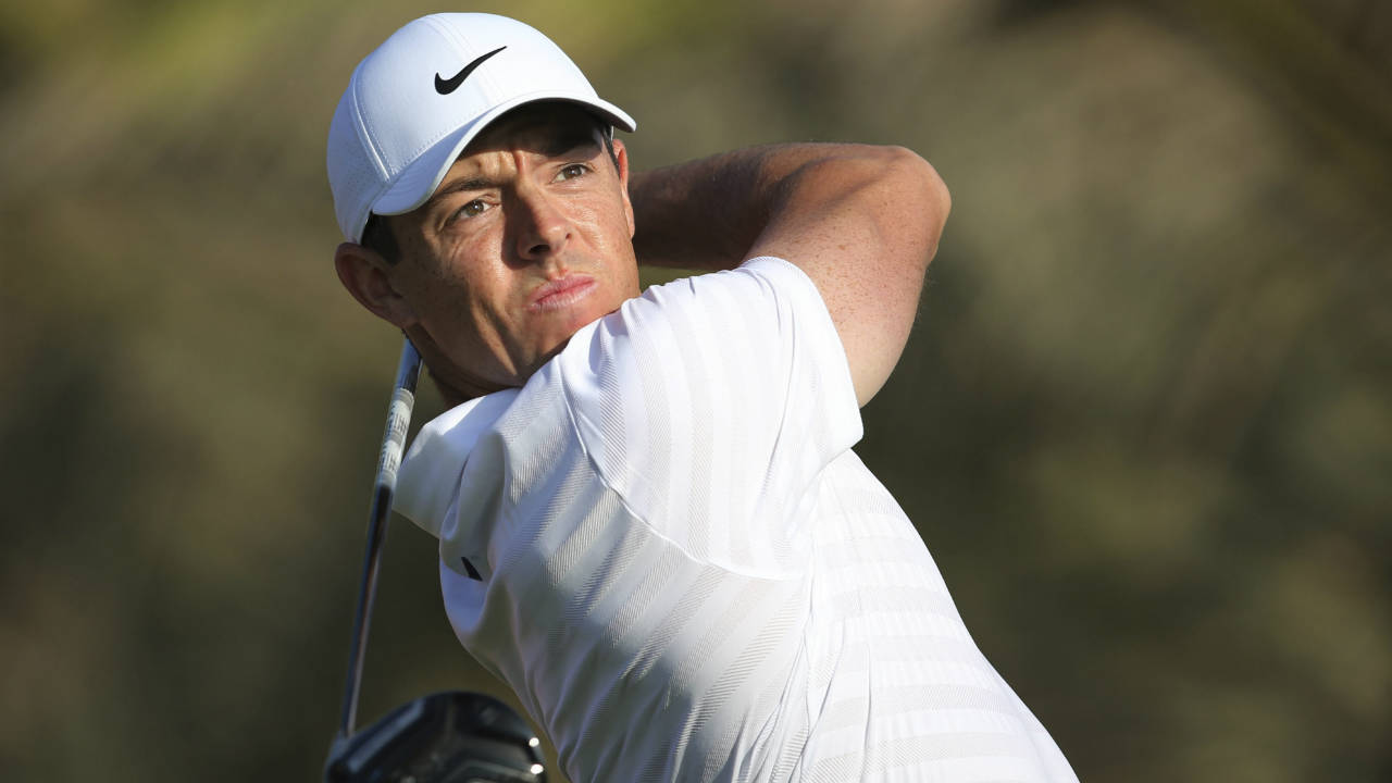 Northern-Ireland's-Rory-McIlroy-tees-off-on-the-14th-hole-during-the-first-round-of-the-Abu-Dhabi-Championship-golf-tournament-in-Abu-Dhabi,-United-Arab-Emirates,-Thursday,-Jan.-18,-2018.-(Kamran-Jebreili/AP)