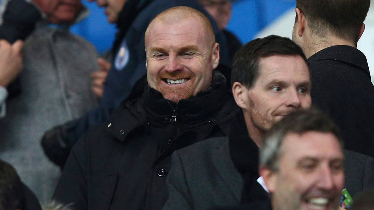 Burnley-manager-Sean-Dyche-in-the-stands-to-watch-the-English-League-Cup-semifinal-first-leg-soccer-match-between-Manchester-City-and-Bristol-City-at-the-Etihad-stadium-in-Manchester,-England,-Tuesday,-Jan.-9,-2018.-(Dave-Thompson/AP)