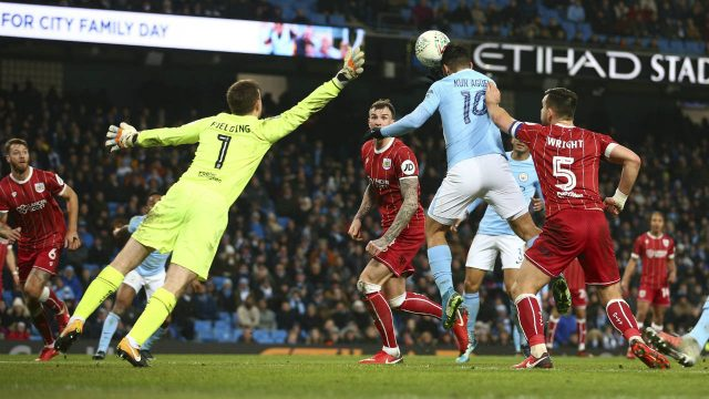Manchester-City's-Sergio-Aguero-scores-his-sides-second-goal-during-the-English-League-Cup-semifinal-first-leg-soccer-match-between-Manchester-City-and-Bristol-City-at-the-Etihad-stadium-in-Manchester,-England,-Tuesday,-Jan.-9,-2018.-(Dave-Thompson/AP)